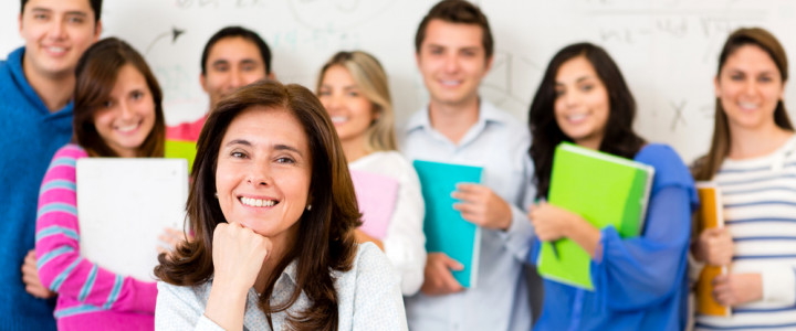 Teacher in a classroom with a group of students